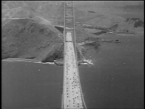 b/w 1937 high angle traffic driving onto golden gate bridge at grand opening / san francisco ca / newsreel - 1937 stock-videos und b-roll-filmmaterial