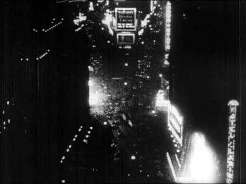 b/w 1928 high angle traffic lights in times square at night / new york city / newsreel - 1928 stock videos & royalty-free footage