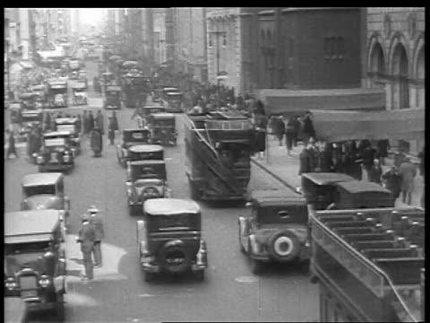 B/W 1927 high angle traffic on city street / educational