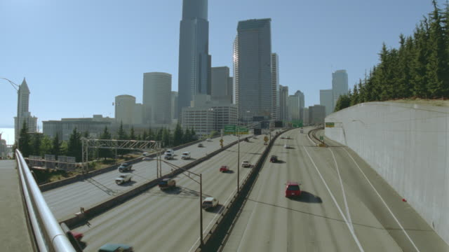 high angle traffic on highway (Interstate 5) / Seattle city skyline in background / Seattle, Washington