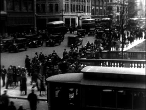 B/W 1921 high angle traffic + pedestrians on busy city street / documentary