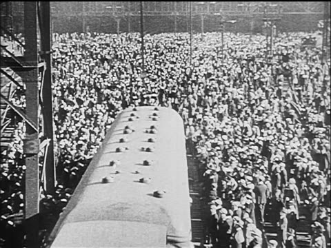 b/w 1917 high angle train pulling away from crowd towards camera / ww i / documentary - 1917 stock videos & royalty-free footage