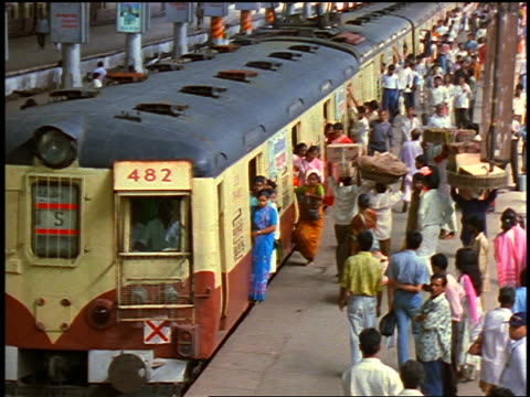 high angle train pulling into crowded station + passengers getting off + on / bombay, india - passenger stock videos & royalty-free footage