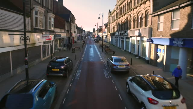 high angle travelling shot of bishop auckland high street in county durham with lots of closed empty shops - merchandise stock videos & royalty-free footage
