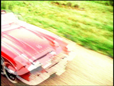 overexposed canted high angle truck point of view time lapse couple driving on country road in 1961 corvette - overexposed stock videos & royalty-free footage