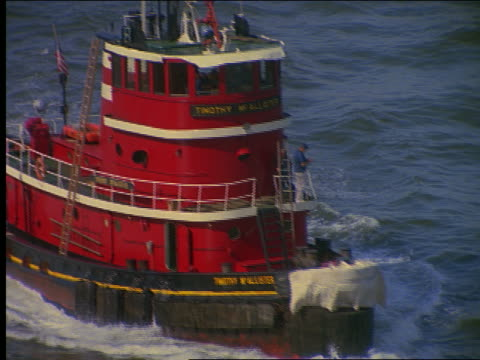 high angle tugboat on river - tugboat stock videos and b-roll footage