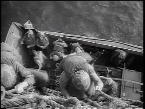 b/w 1965 high angle us marines climbing down ropes from ship into landing craft boat / vietnam war - landungsboot stock-videos und b-roll-filmmaterial