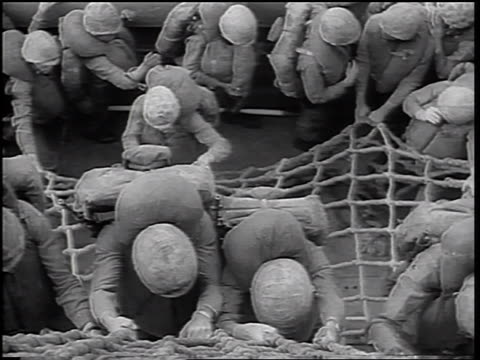 b/w 1965 high angle us marines climbing down ropes from ship into landing craft boat / vietnam war - landing craft stock videos & royalty-free footage