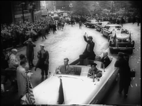 stockvideo's en b-roll-footage met b/w 1958 high angle van cliburn sitting in convertible raising arms in nyc parade / newsreel - van