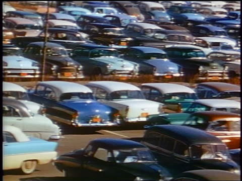 1958 high angle pan very crowded parking lot / people walking / newsreel - 1958 stock videos & royalty-free footage