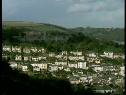 t/l wa high angle view across kingsbridge town, dartmouth, large grand building on hillside in background, clouds casting shadows - dartmouth england stock videos & royalty-free footage