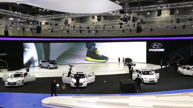 high angle view attendees walk between vehicle stands during the press day of the 2013 seoul motor show in goyang high angle view employees clean and... - goyang stock videos and b-roll footage
