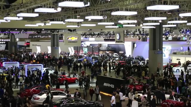 high angle view attendees walk between vehicle stands during the press day of the 2013 seoul motor show in goyang pull out high angle view seoul... - goyang stock videos and b-roll footage