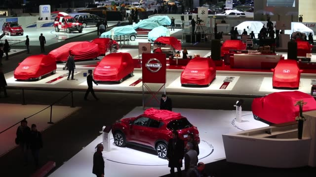 high angle view collection of automobiles covered by protective cloths seen on company stands ahead of the opening day of the 83rd geneva... - ぞうきん点の映像素材/bロール