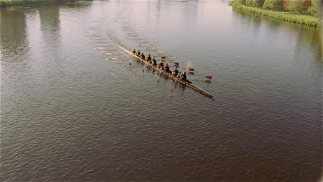 High angle view crew team rowing racing shell on Charles River