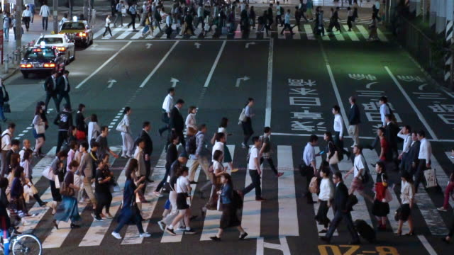 high angle view crowd walking people at zebra cross in ueno,tokyo,japan. - crossroad stock videos & royalty-free footage