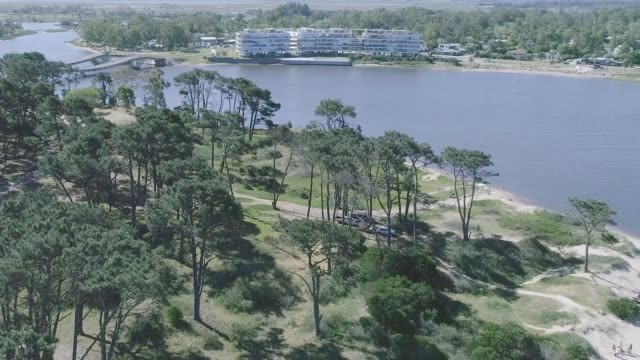 high angle view, drone point of view, view of la barra bridge, punta del este city, uruguay - tranquillising stock videos & royalty-free footage