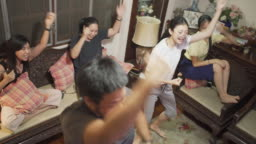 High angle view family dancing together with TV coach in covid-19 virus lockdown