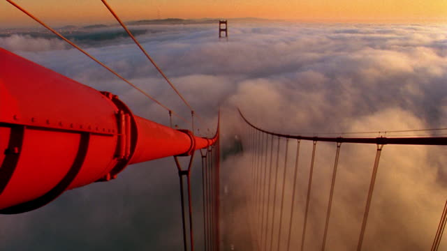 High angle view from top Golden Gate Bridge tower of sea of fog covering San Francisco Bay / California