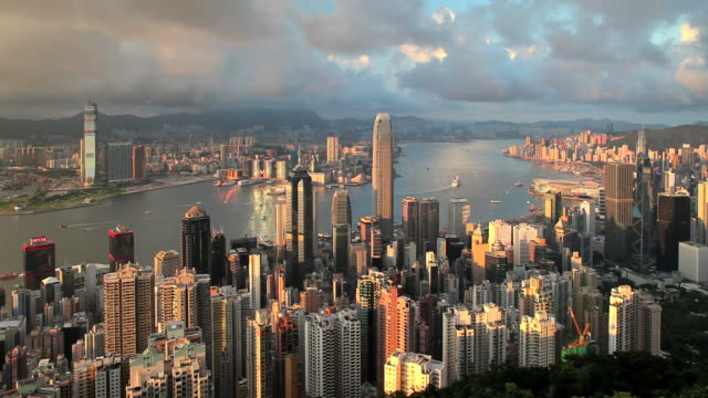 high angle view from victoria peak, mount austin,, hong kong island, looking across harbour towards kowloon - bank of china tower hong kong stock videos and b-roll footage