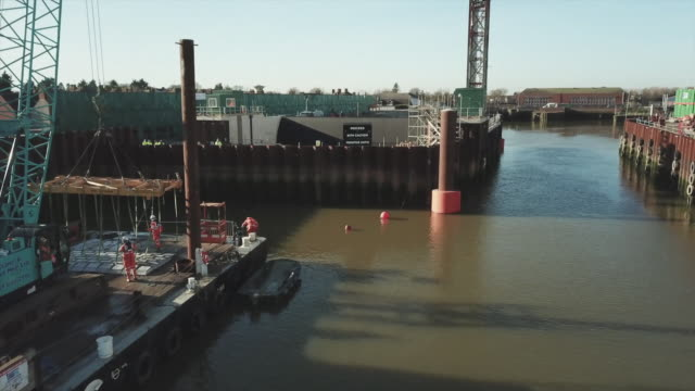 high angle view of a flood barrier being constructed - construction frame stock videos & royalty-free footage