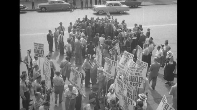 high angle view of a group of proalben barkley supporters with placards walking in the street and grouping around the candidate / adlai stevenson... - alben w. barkley stock videos and b-roll footage