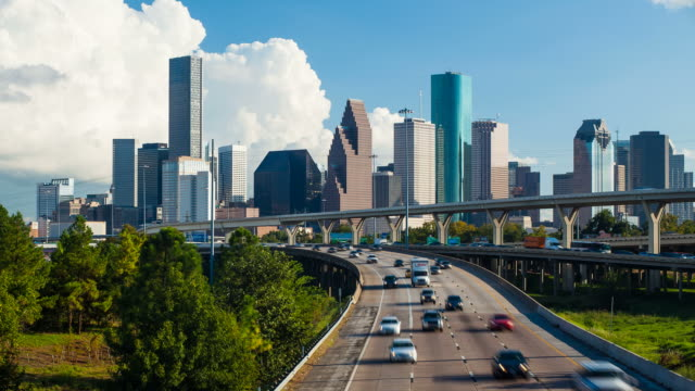 high angle view of a multiple lane highways with skyscrapers in the background, houston, texas, usa - texas stock videos & royalty-free footage