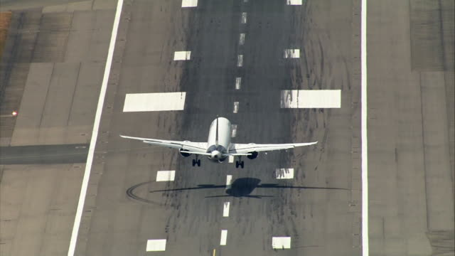 high angle view of a plane landing on a runway - aeroplane stock videos & royalty-free footage