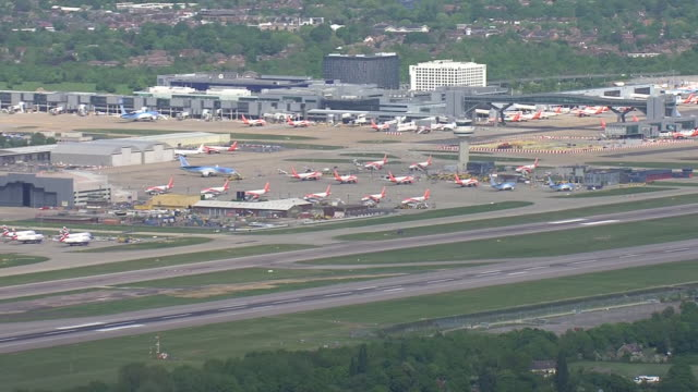 high angle view of a plane taking off from gatwick airport - west sussex stock videos & royalty-free footage
