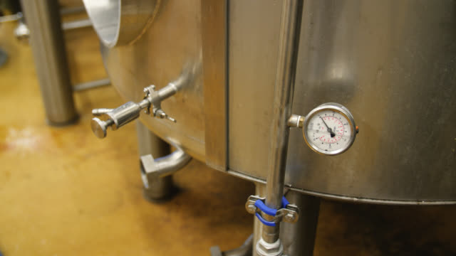 High angle view of a pressure gauge on the side of a beer brewing tank