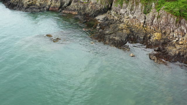 high angle view of a rocky section of coastline at a scottish beach on a summer day - johnfscott stock videos & royalty-free footage