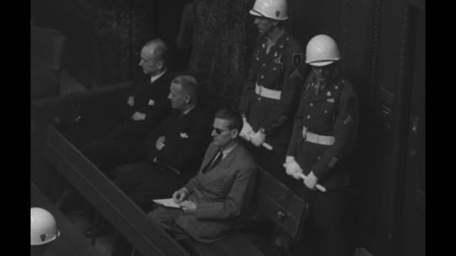 vs high angle view of a score of jurists and attorneys in the courtroom along with military police / vs nazi defendants in the box karl doenitz erich... - nuremberg trials stock videos & royalty-free footage