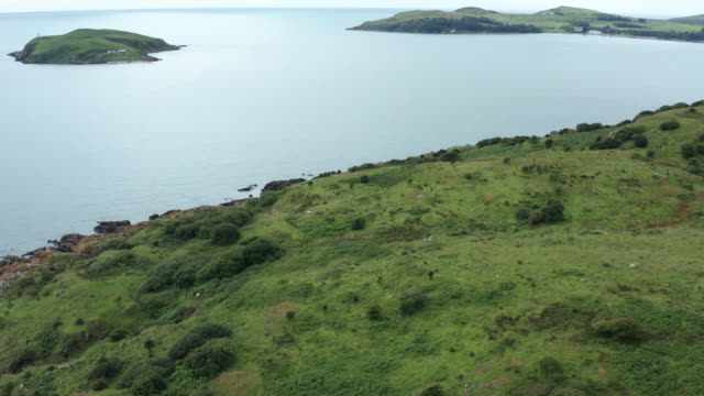 high angle view of a section of scottish coastline on a summer day - johnfscott stock videos & royalty-free footage