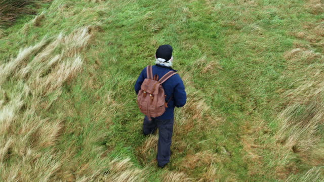 high angle view of an active senior man hiking in a remote rural location in south west scotland - galloway scotland stock videos & royalty-free footage