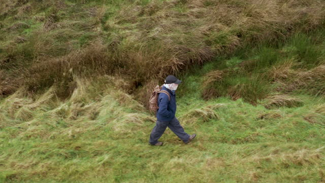 high angle view of an active senior man out walking in a remote rural location in south west scotland - brown stock videos & royalty-free footage