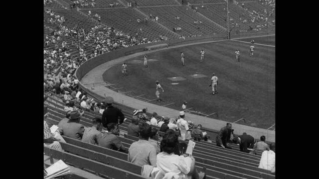 high angle view of audience watching baseball players practicing baseball on baseball diamond before game - fielder stock videos & royalty-free footage