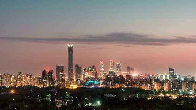 vidéos et rushes de t/l ws ha zi angle élevé découvre toits de beijing de nuit / pékin, chine - investissement