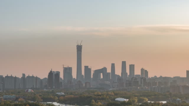 t/l pan high angle view of beijing skyline, from day to sunset - pechino video stock e b–roll