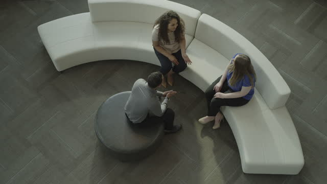 high angle view of business people talking in office lobby / provo, utah, united states - provo stock videos & royalty-free footage