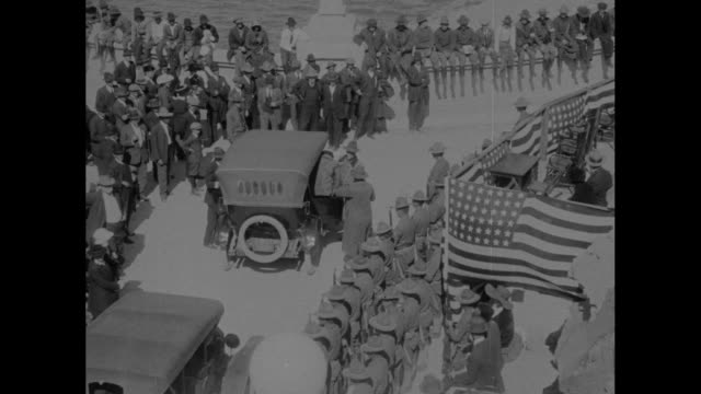 high angle view of car stopping and person getting out two rows of uniformed people and american flag at right / a a jones personal representative of... - 1916 stock videos & royalty-free footage
