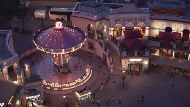 high angle view of carousel in prater park  of vienna at twilight, austria - prater park stock videos & royalty-free footage