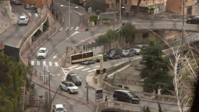 high angle view of cars and people on street in city - monte carlo, monaco - wide angle stock videos & royalty-free footage