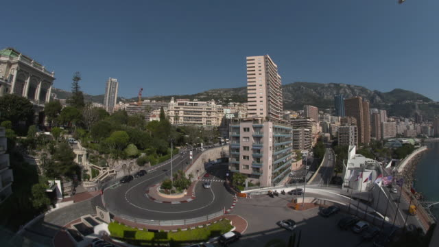 high angle view of cars going round the famous hairpin bend in monte-carlo with grand prix markings on the side of the road - monaco stock videos and b-roll footage