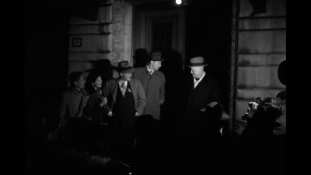 high angle view of cheering crowd / dwight eisenhower walks out of building into the night flashbulbs pop / women wave / vs mamie eisenhower dwight... - 1952 stock videos and b-roll footage