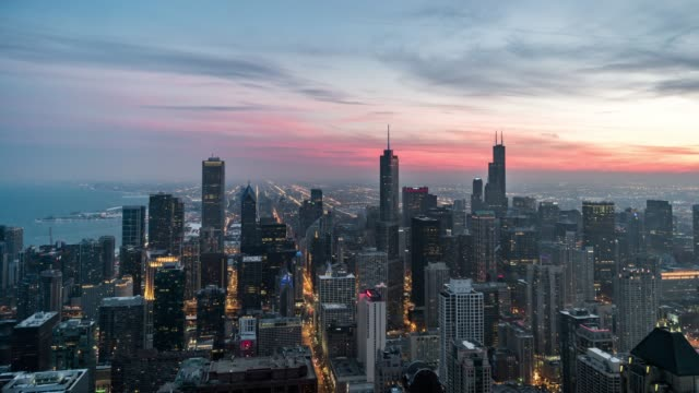 t/l high angle view of chicago skyline, sunset to night transition - chicago loop stock videos and b-roll footage