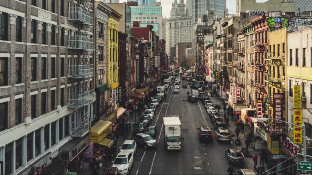 t/l pan high angle view of chinatown from manhattan bridge / nyc - city street sign stock videos and b-roll footage