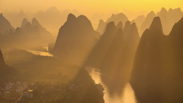 high angle view of chinese mountains-and-waters landscape in guilin - karst formation stock videos & royalty-free footage