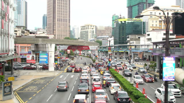 high angle view of city rush hour traffic in kuala lumpur, malaysia - kuala lumpur stock videos & royalty-free footage