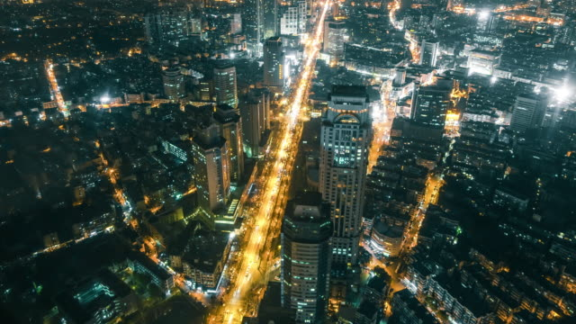 high angle view of city traffic at night - gerade stock-videos und b-roll-filmmaterial