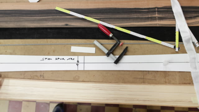 vídeos y material grabado en eventos de stock de high angle view of craftsperson working in workshop - one mature man only